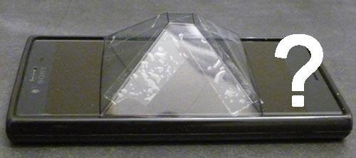 Gedrehte Pyramide auf dem Smartphone Display